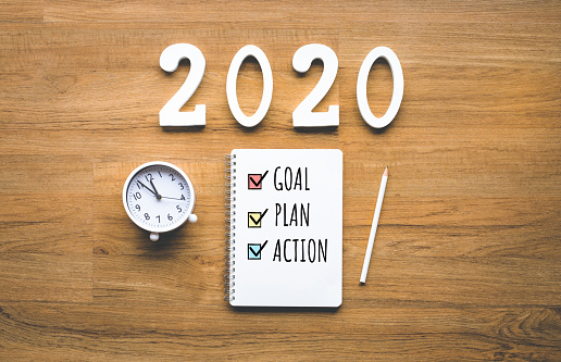 istock 2020 new year goal,plan,action text on notepad on wood background.Business challenge.Inspiration ideas 1166631072