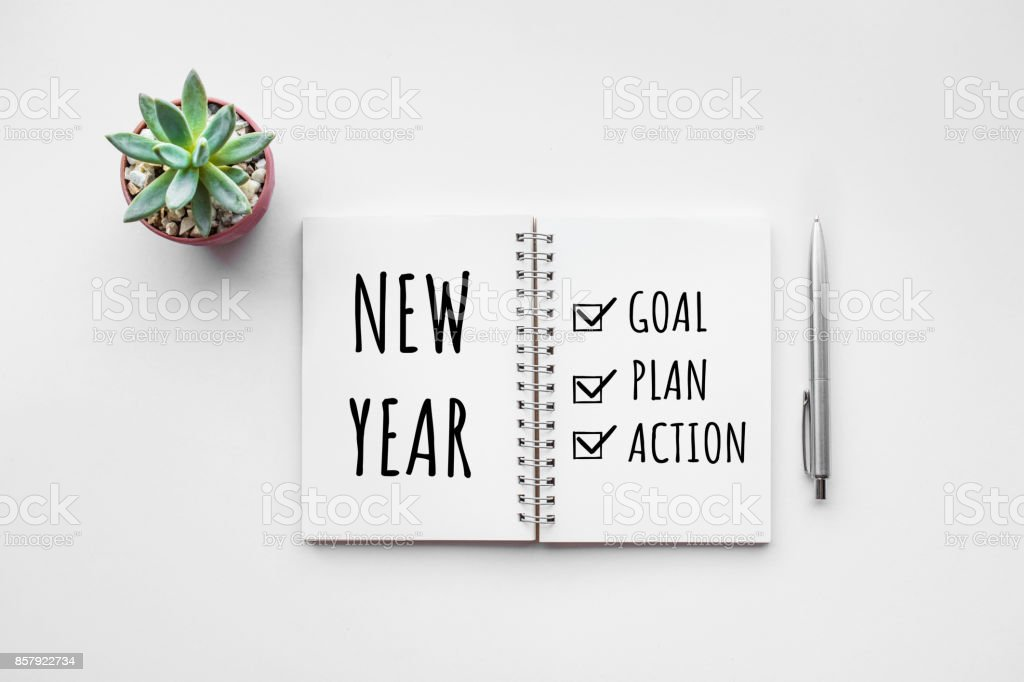New year goal,plan,action text on notepad stock photo