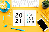 istock 2021 new year goal,plan,action text on notepad with office accessories.Business management,Inspiration concepts 1267168722