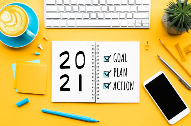 2021 new year goal,plan,action text on notepad with office accessories.Business management,Inspiration concepts 2021 new year goal,plan,action text on notepad with office accessories.Business management,Inspiration concepts ideas wishing stock pictures, royalty-free photos & images