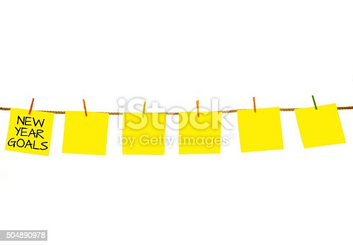 istock New Year Goals on Yellow sticky notes hanging on clothesline 504890978