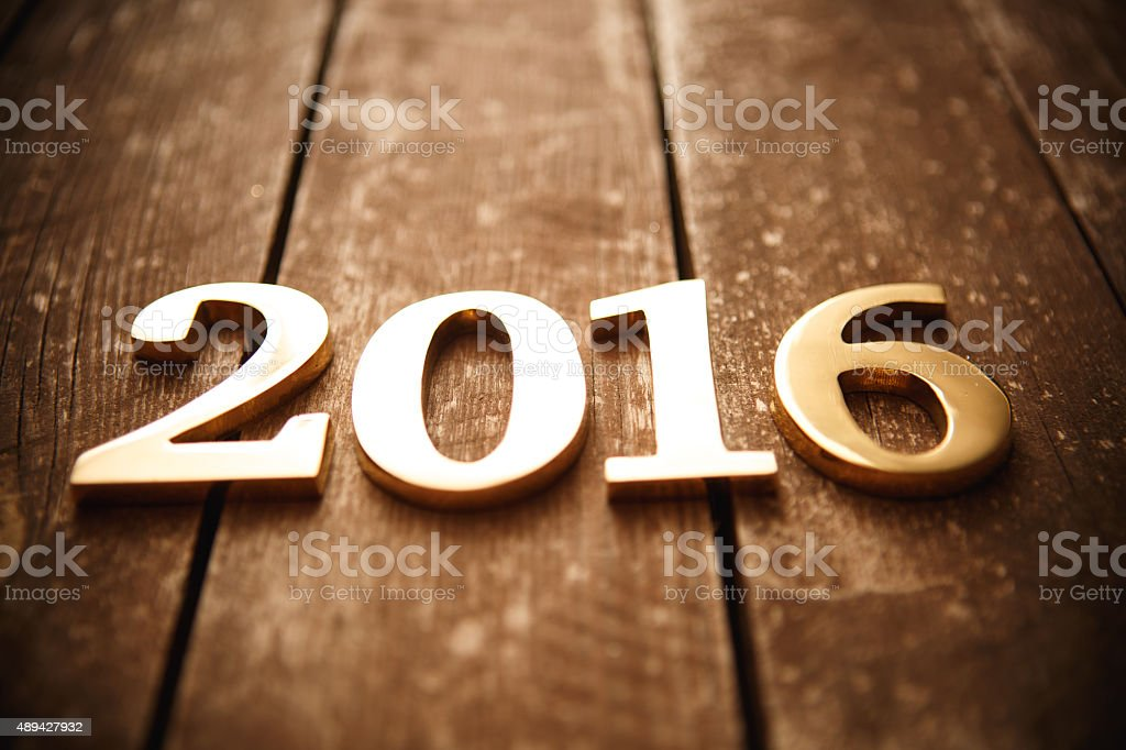 New year gold (metal) text on wood stock photo