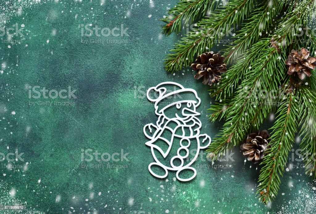 New year green background. New Year decoration with a snowman. Happy New Year and Merry Christmas! stock photo