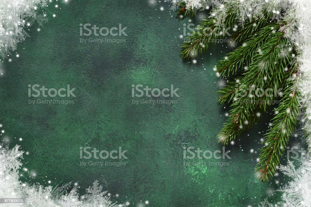 New year green background. New Year decoration with snowflakes and cones. Happy New Year and Merry Christmas! stock photo