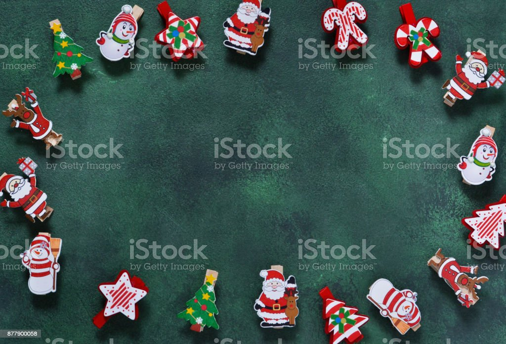 New Year green background with decorative clothespins. Happy New Year and Merry Christmas! stock photo