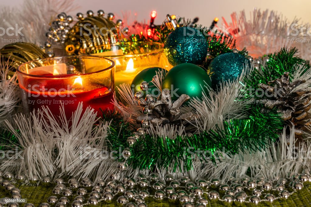 New Year Green Balls And Decorations For The Christmas Tree Bright And Beautiful Scenery On A Lemon Background With White Tinsel And Beads Stock Photo