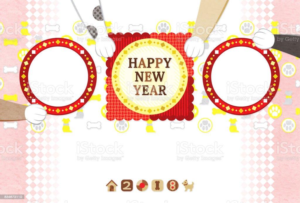 新年グリーティング カード 2018 料理と犬の手フォト フレーム新年あけましておめでとうございます ロイヤリティフリーストックフォト