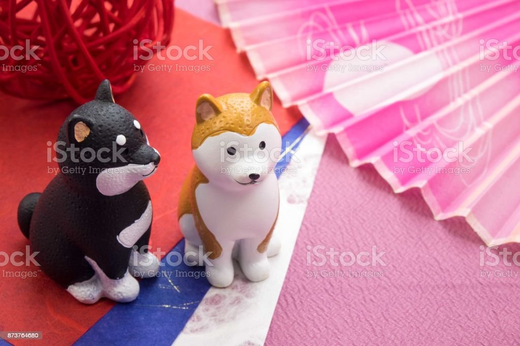 New Year image 'Dog's Figurine' and 'Fan' stock photo