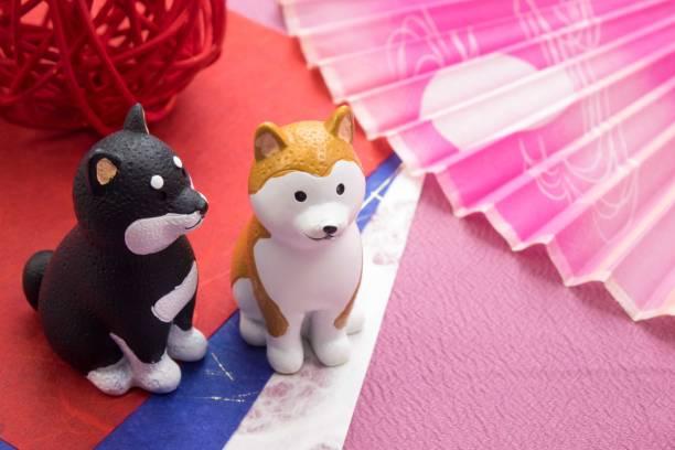 Nouvel an image «Figurine de chien» et «Fan» - Photo