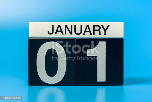 istock New year. January 1st. Day 1 of december month, calendar on blue background. Winter time 1194736412