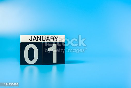 istock New year. January 1st. Day 1 of december month, calendar on blue background. Winter time 1194736463