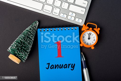 istock New year. January 1st. Day 1 of december month, calendar with little christmas tree on office desk. Winter time 1193509057