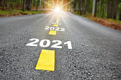 istock New year journey 2021 to 2024 on asphalt road surface with marking lines and sunlight 1280294961
