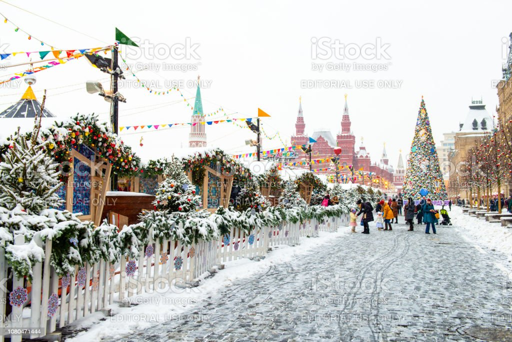 New year market in Moscow. Snowy Red Square in Moscow. People preparing for Christmas and New year. Winter walk on the street. stock photo