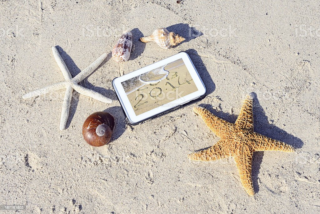 New Year Message on Tablet in the Sand royalty-free stock photo