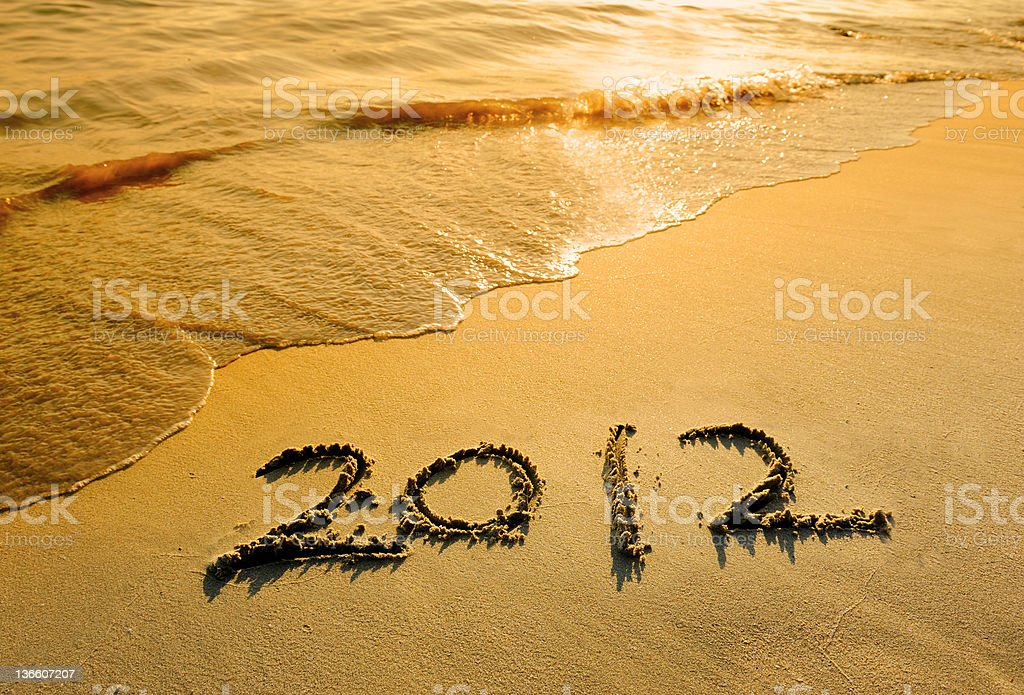 new year message on the sand beach stock photo