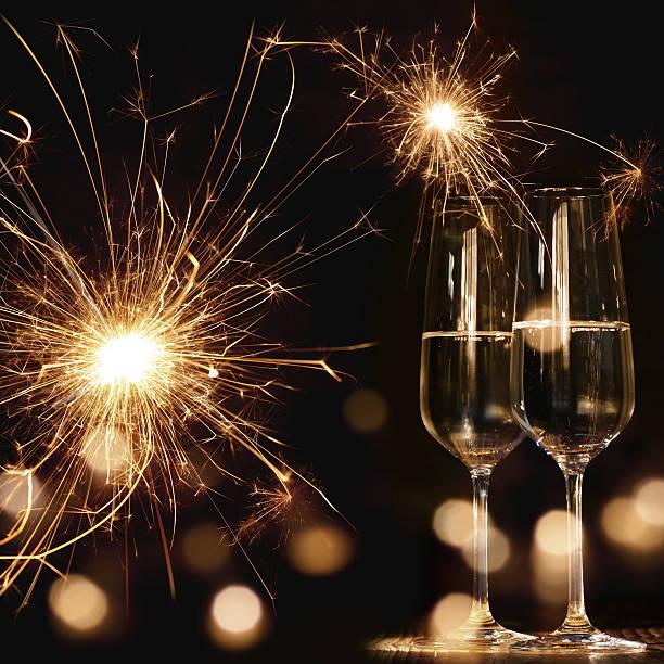 new year motif with fireworks and champagne - eventos de gala - fotografias e filmes do acervo
