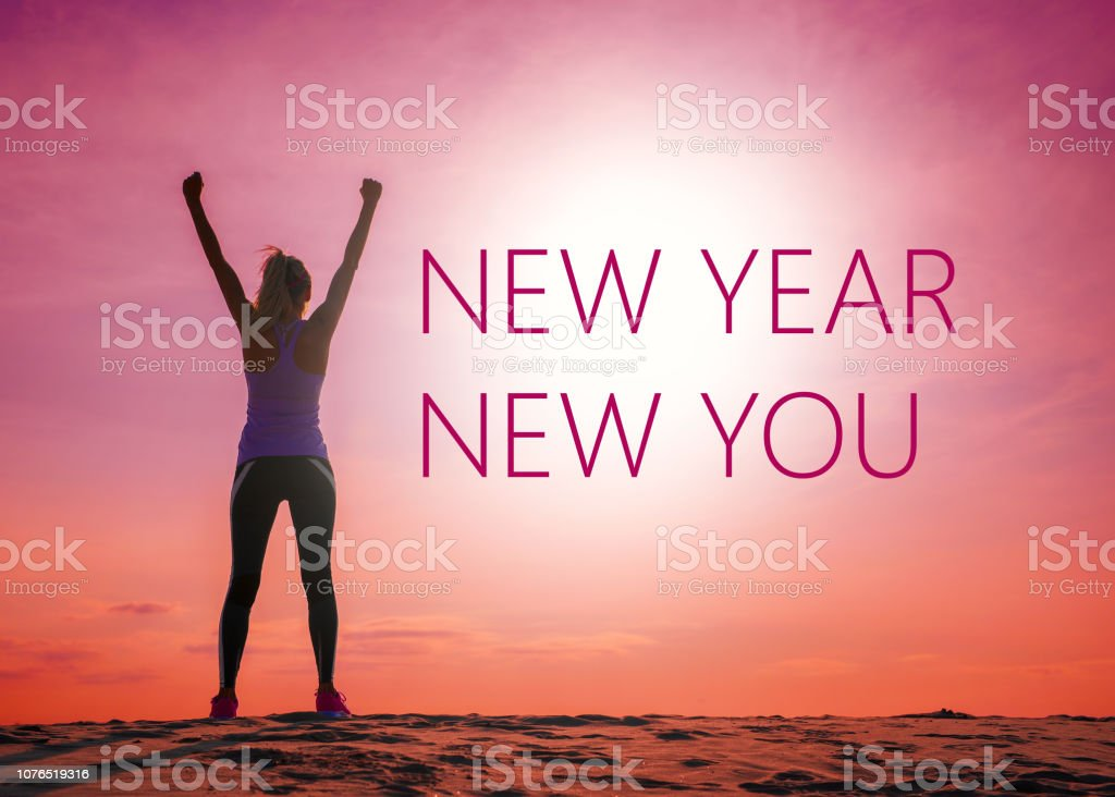 New year new you text quote on the image of womans silhouette at sunrise. stock photo