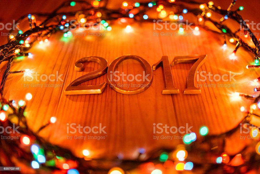2017 new year on plank wood with christmas lights royalty-free stock photo