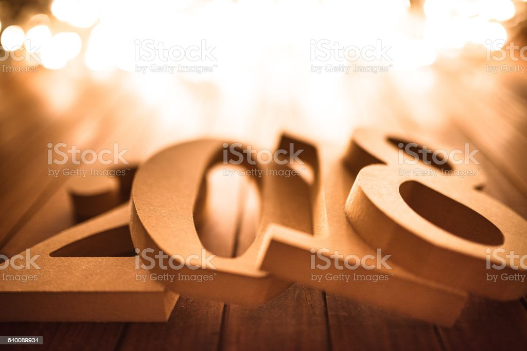 2018 new year on plank wood with christmas lights stock photo