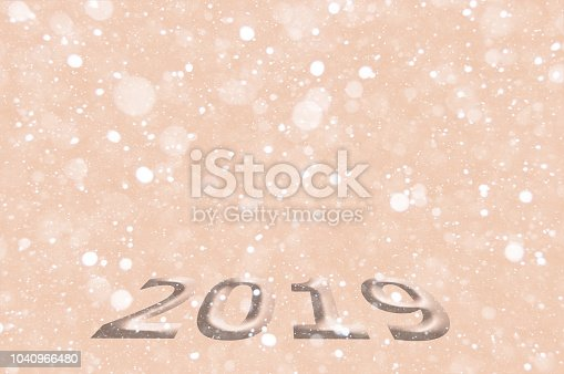 1018011484 istock photo New Year or Christmas background 2019. Background with a volume inscription, bokeh effect. Can be used for postcards, posters, invitations, banners and brochures. Selective focus, mockup 1040966480