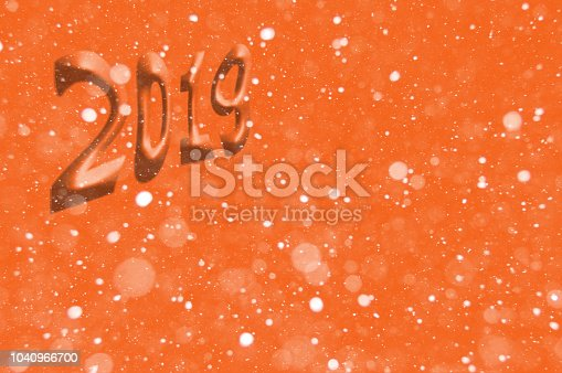 1018011484 istock photo New Year or Christmas background 2019. Background with a volume inscription, bokeh effect. Can be used for postcards, posters, invitations, banners and brochures. Selective focus, mockup 1040966700
