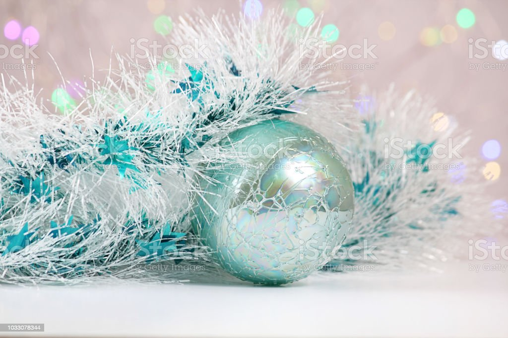 new year or christmas decorations on an abstract background bokeh effect white tinsel with