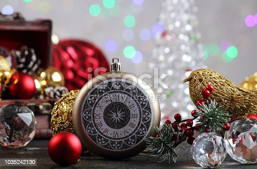 505891506 istock photo New Year or Christmas decorations on an abstract background, bokeh effect. Can be used as wallpaper or greeting card. Selective focus, copy space. 1035242130