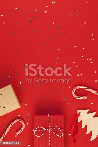 istock New Year or Christmas presents red background 1030751396