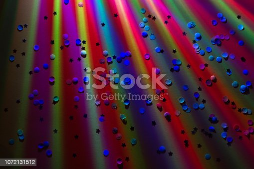 istock New year party birthday colorful abstract background with lights in night 1072131512