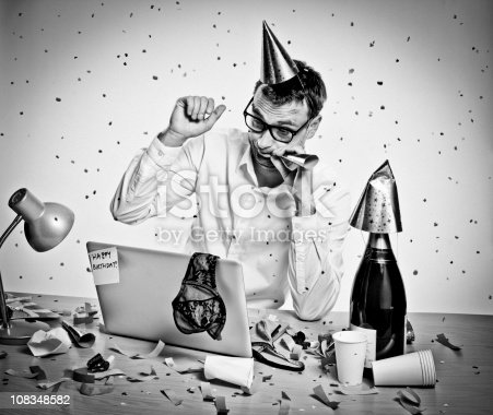 618210072 istock photo New Year Party, Birthday, hungover man behind laptop, office, retro 108348582