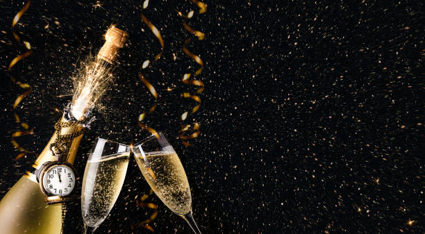 New year party concept with a exploding champagne bottle stock photo