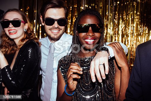 istock New Year Party, Happy people smiling and hugging 1059781588