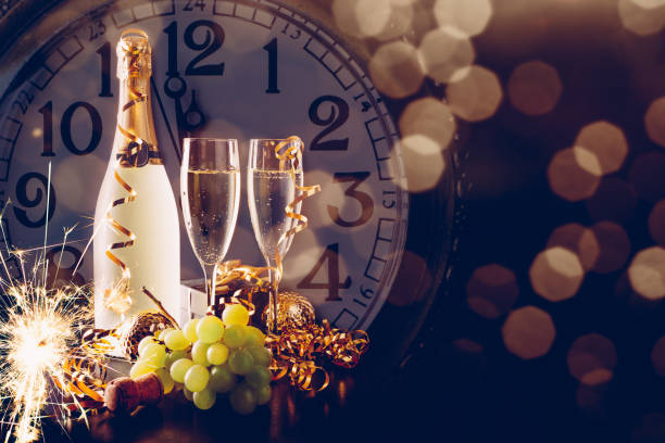New Year party with champagne and grapes stock photo