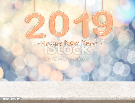 istock 2019 new year peace color (3d rendering) hanging over marble table top with pastel blue and orange sparkling bokeh light,Holiday concept,leave space for adding your content. 1061282712