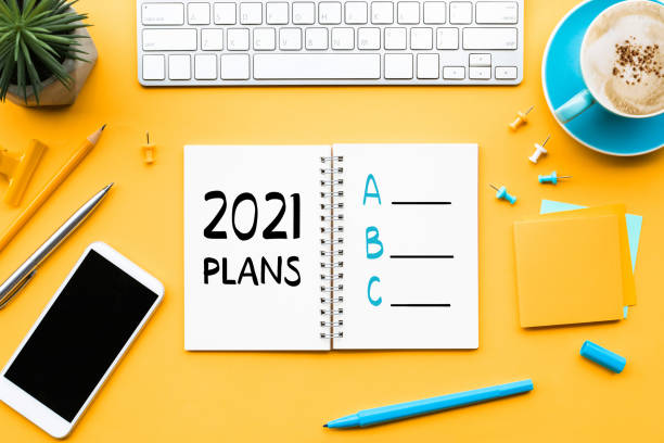 2021 new year plan a,b,c concepts with text on notepad and office accessories.Business management stock photo