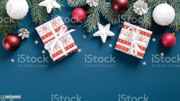 New year presents wrapped festive paper white and red balls stars picture id1185256863?b=1&k=6&m=1185256863&s=612x612&h=9zvtlztphwti ishl2aop29fx4 yyb14ru7let2qvhg=