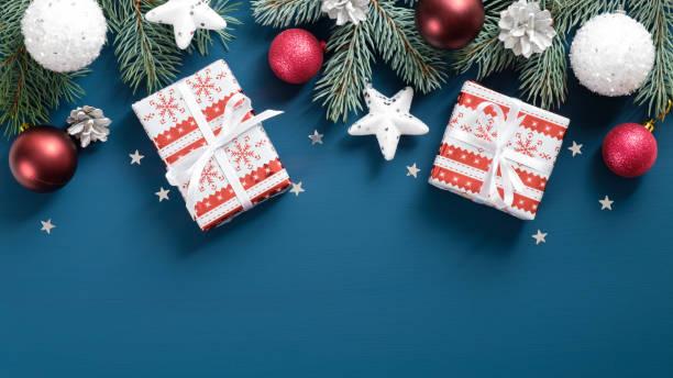 New year presents wrapped festive paper white and red balls stars picture id1185256863?b=1&k=6&m=1185256863&s=612x612&w=0&h=nftjcebfndrcjpiskyo5dylbdat ioi0jbc8aio zw8=