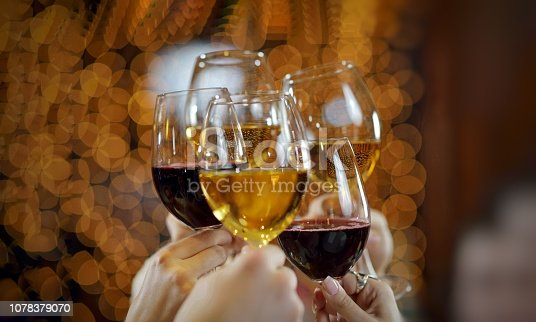 New year Red wine glass celebration 2019. hand with lots of alcoholic drink