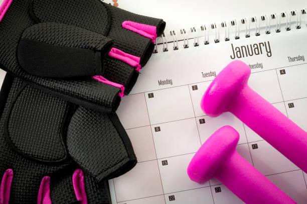 nyårslöfte och komma i form-konceptet - calendar workout bildbanksfoton och bilder