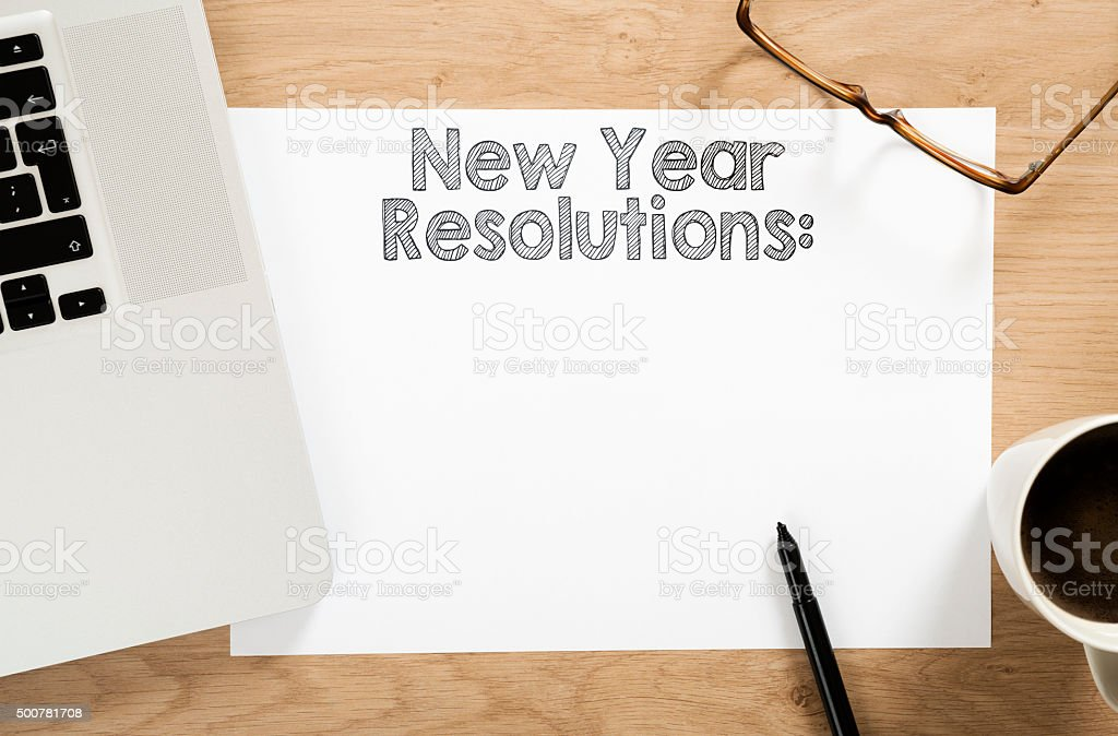 new year resolution written paper stock photo