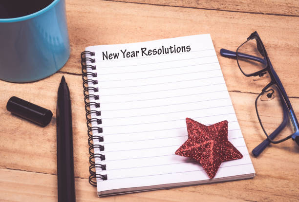 New Year Resolutions List in Notepad stock photo
