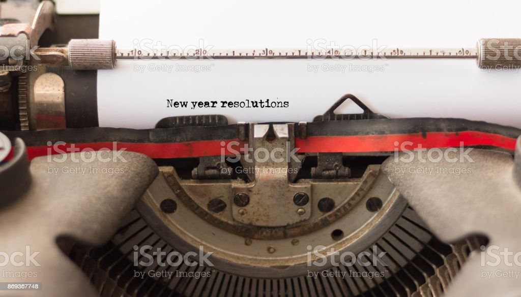 New Year Resolutions text written by old typewriter machine, close up stock photo