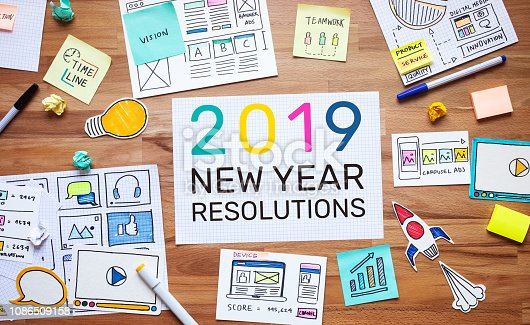 istock 2019 new year resolutions with business digital marketing and paperwork sketch on wood table.analysis strategy concepts 1086509158