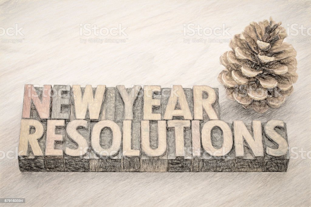 New Year resolutions word abstract in wood type stock photo