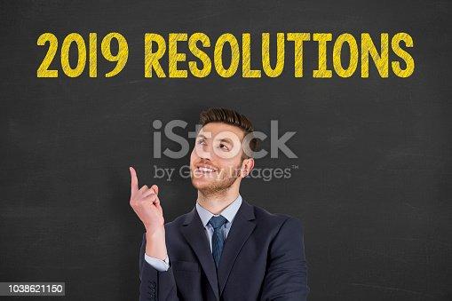 1069595584 istock photo New Year Resoulutions 2019 over Human Head on Chalkboard 1038621150