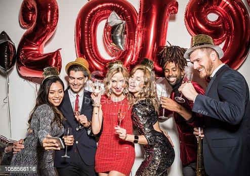 istock New year selfie 1058566116