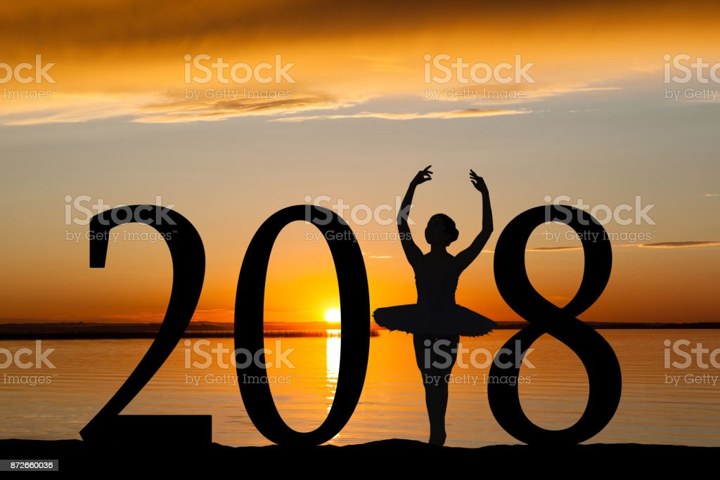 2018 New Year Silhouette of Ballet Girl at Golden Sunset stock photo