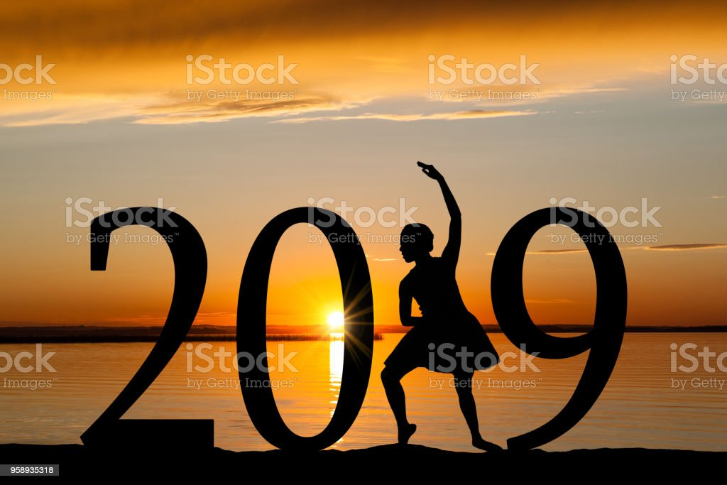 2019 New Year Silhouette of Ballet Girl at Golden Sunset stock photo