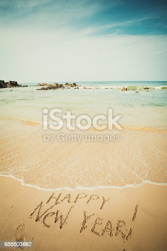 istock New Year text on the sea beach. 655503662